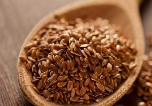 Flaxseeds In wood spoon