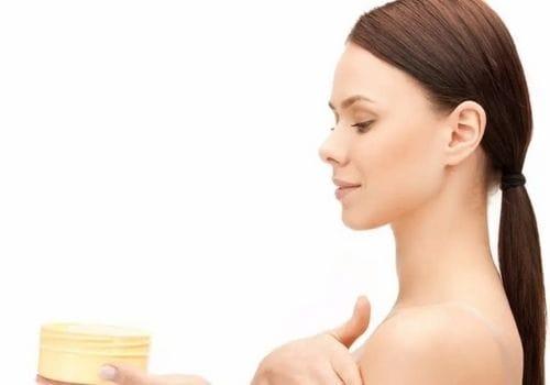 girl use cream on hos body
